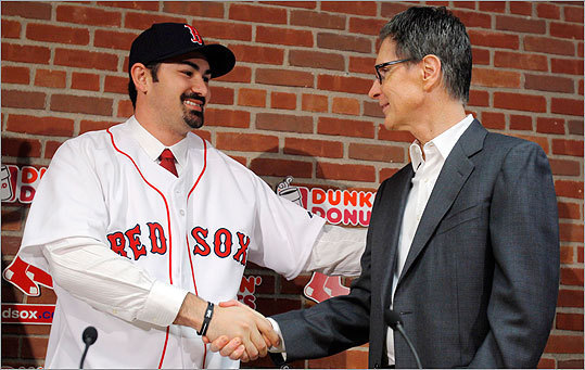 Pictured, Gonzalez shook hands with Red Sox principal owner John Henry, who is no stranger to the player. In 2000, Henry was the owner of the Florida Marlins when the team selected Adrian Gonzalez with the first overall pick in that year's MLB draft.