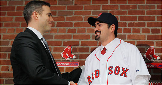 Pictured, Gonzalez shook hands with Red Sox general manager Theo Epstein, who must now turn his attention to baseball's winter meetings this week in Orlando.
