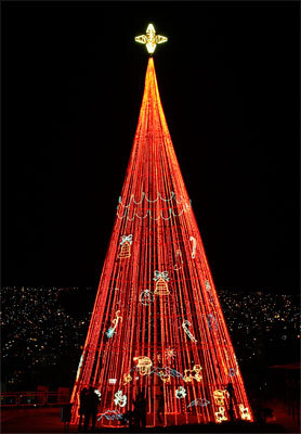 Bolivia People look at a Christmas tree at Mirador de Laikacota in La Paz, Bolivia. Measuring more than 80 feet, the tree can be seen from anywhere in this Andean city