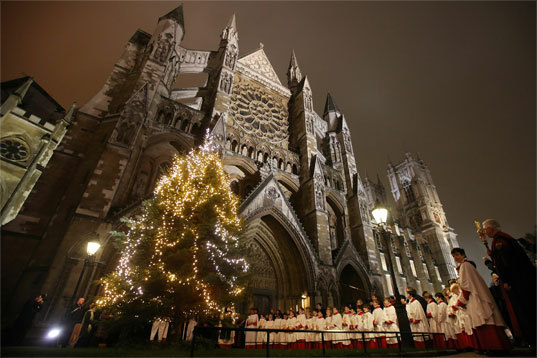 United Kingdom Choristers of Westminster Abbey stand as a 25 foot Christmas Tree is illuminated on the North Green of Westminster Abbey on December 6 in London.