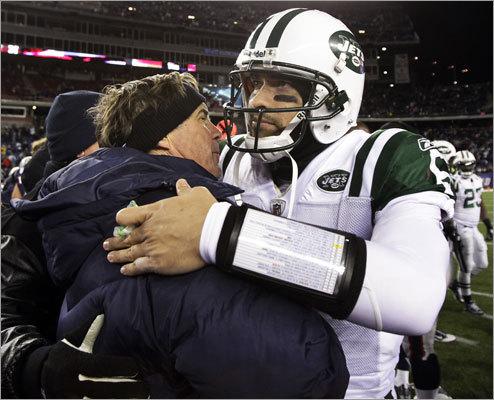 Patriots coach Bill Belichick met with quarterback Mark Sanchez after New England's 45-3 win.
