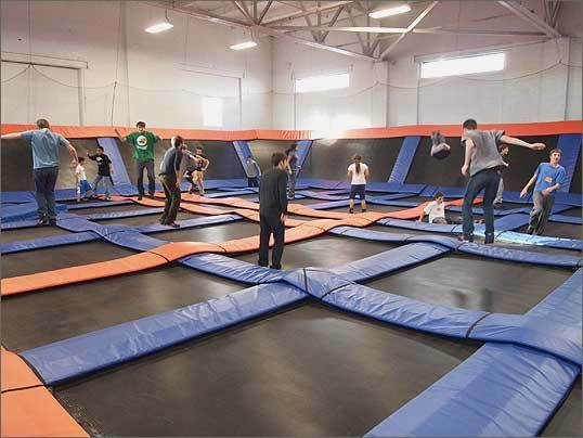 More than 1,000 people have come out for a jump in the first 10 days of business at Hyde Park's Sky Zone indoor trampoline park. Sky Zone's trampoline courts are made up of many small trampolines arranged in a grid, with thick layers of padding covering the metal support structure. The walls of each court are trampolines set at an angle, so there's no danger of bouncing off the side. Only the entrance to each court is open, and there are strictly enforced no-bouncing rules for jumpers entering and leaving. Read the full story
