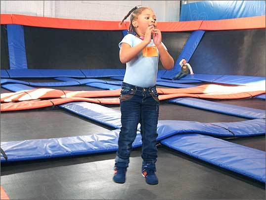At Sky Zone, smaller children are allowed on trampolines, but below a certain height they must play in the toddlers' area where no adults or larger kids are allowed on the court. Pictured right is Khoral Jones, 5, bouncing on Sky Zone's large court.