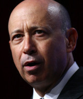 Goldman Sachs chief executive Lloyd C. Blankfein will collect about $24.3 million, despite a drop in the firm's stock.