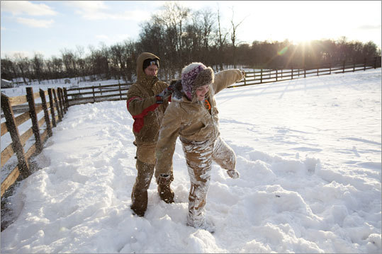 Although doctors were unsuccessful in attempts to save her leg, Bridget does not left her disability keep her from being active. Here she has snow patted off of her by her brother Christian Gonzalez, 18, after she made a snow angel following a recent snowfall.