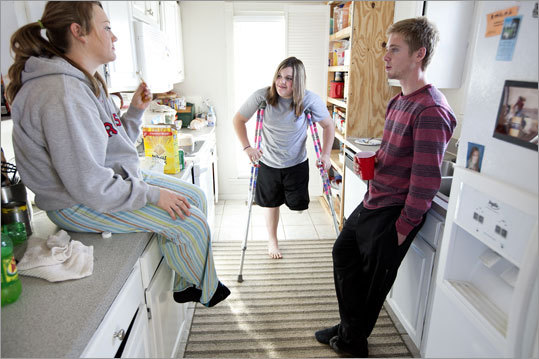 Bridget (center) stands in the kitchen with her siblings Christian Gonzalez (right) and Cheyanne Johnson. Cheyanne was with Bridget on the day of the accident, riding another horse.