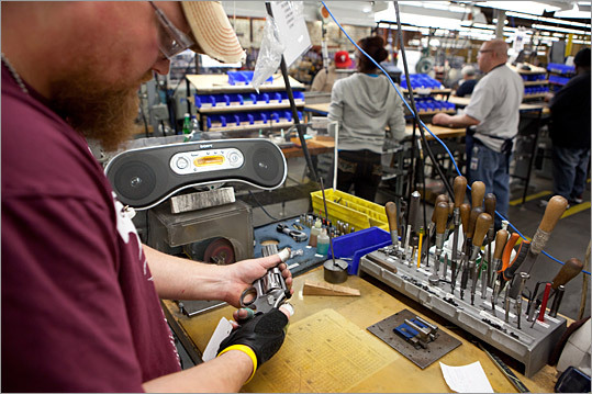 Jeremy Kislus is seen assembling a handgun at the Smith & Wesson plant in Springfield. Smith & Wesson plans to invest in the plant and add 225 jobs, aided by $6 million in tax incentives the state approved yesterday.
