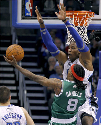 Howard (right) blocked a shot by guard Marquis Daniels during the second half.