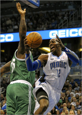 Howard (right) drove against Celtics center Shaquille O'Neal in the first half.