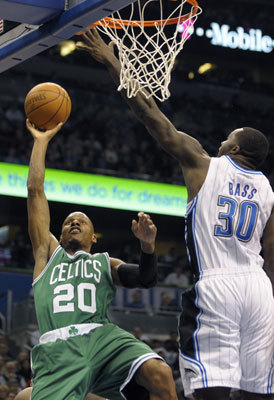 Celtics guard Ray Allen (left) put up a shot in front of Bass during the first half.