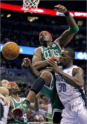 Magic forward Brandon Bass was fouled by Celtics center Jermaine O'Neal during the second half.