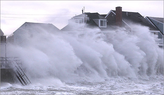 Waves crash on a house on Oceanside Drive during the mid-afternoon on Monday. Several dozen people were evacuated Monday from their homes in Scituate due to flooding, said Town Administrator Patricia Vinchesi. Town officials say there was damage in the seawall, between Seventh and 11th avenues during the storm. Latest news from Scituate | Full blizzard coverage