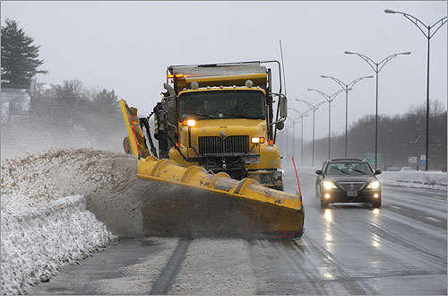 The storm that rolled into Massachusetts and dumped as much as 18 inches of snow in some areas gave way to a massive cleanup effort on Monday. A Massachusetts Department of Transportation snowplow and sanding truck worked to clear roads in and around Boston.
