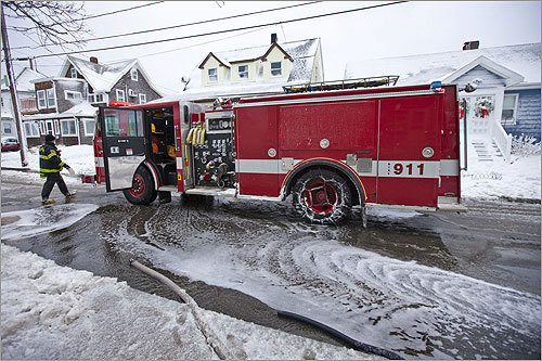 Flooding became so bad on Pico Avenue in Winthrop that firefighters had to set up pumps and hoses to remove water from homes along the street.