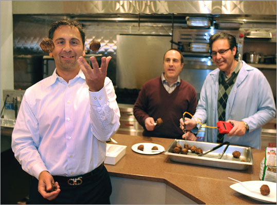 A classic comfort food -- the meatball — is making a comeback. In a processing plant off Route 1 in Norwood, Home Market Foods' Cooked Perfect brand meatballs are flame broiled, flash frozen, packaged and sent off to retailers. Wesley Atamian, president of Home Market Foods, jokingly tosses a few meatballs as his brother Douglas Atamian, chief executive of the company (middle), and Research and Development Director Vahid Shahram (right) look on.