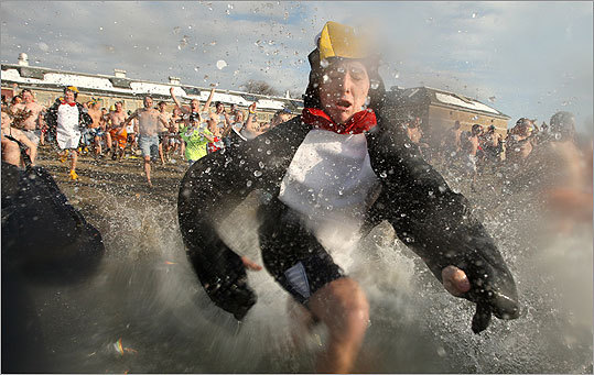 One of five men who came dressed in penguin suits hit the water.