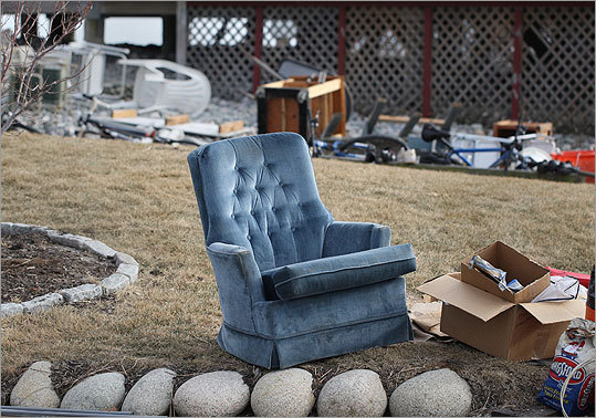 A home on Oceanside Drive has items outside on their lawn damaged from the storm.