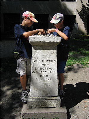 Revere's grave is one of the many famous ones in the Granary Burying Ground near the Boston Common. Others buried nearby include John Hancock, the victims of the Boston Massacre, Samuel Adams, and Mother Goose. Pictured: Liam Greenlee, left, and Aidan Greenlee at the grave stone.
