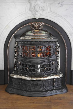 ''The biggest thrill for me is putting the first fire back in something that's been sitting, oftentimes 40 or 50 years, this reclusive rusty old cookstove that's been down in the cellar of someone's farm,'' he said. ''And we literally light the first match and breathe new life back into it.'' This 1887 Splendid Heater is a Victorian fireplace insert that he restored.