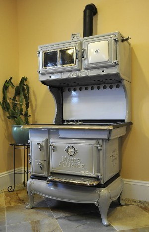 But sometimes he comes across beautiful old stoves that have been irreparably damaged from high temperatures. The stoves are too impressive to discard, so Erickson began adding new components, to allow them to work in new ways. He'll take a century-old stove and add a new cooktop and electric oven, hiding the controls behind a door. He restored and converted this 1924 Magee Alliance stove for a local kitchen design business.