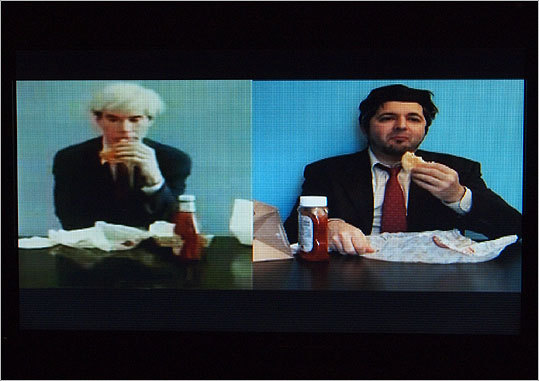 "For his video ""Andy Warhol Eats Hamburger. Peter Pizzi Eats Veggieburger,"" artist Peter Pizzi reenacted a famous video of the pop-art icon enjoying a Burger King Whopper. The original sequence appeared in Jørgen Leth's film ""66 Scenes from America."""
