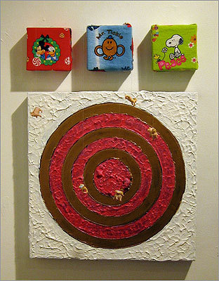 "The famous target paintings of artist Jasper Johns were the starting point for Sonia Domkarova's ""Target with Four Faces."" She took a set of images intended to be dour and disturbing, and she instead made them whimsical — and possibly more disturbing. The tiny objects suspended from string in front of the targets are plastic babies and pigs."