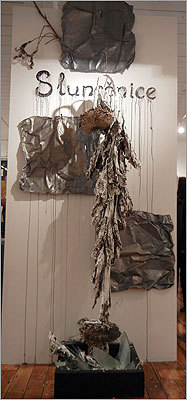 "Czech immigrant Bo Petran used a dried-up, white-washed sunflower as the central image of his mixed-media sculpture ""Slunečnice. Homage to Anselm,"" which borrows the style of German artist Anselm Kiefer. Slunečnice is the Czech word for sunflower."