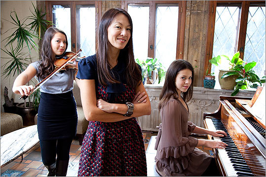 Amy Chua in her home in New Haven, Conn. with her daughters Lulu (left) and Sophia.