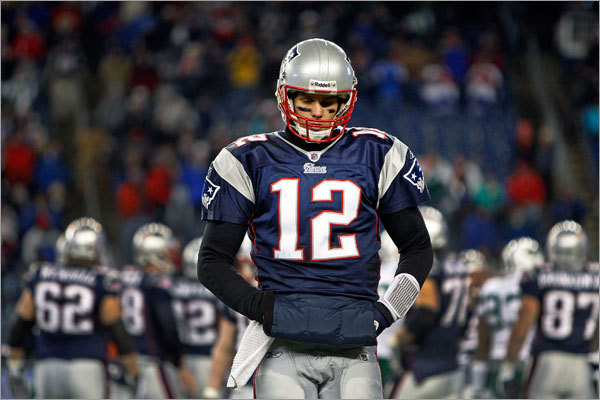 Patriots quarterback Tom Brady walks back to the bench after the final play of his team's season.
