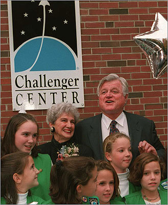 NASA plans a public Day of Remembrance at the Kennedy Space Center in Florida. At left, Corrigan shares a moment with Senator Edward M. Kennedy and a group of girl scouts at a 1994 dedication ceremony of the Christa Corrigan McAuliffe Center and Challenger Learning Center at Framingham State College.