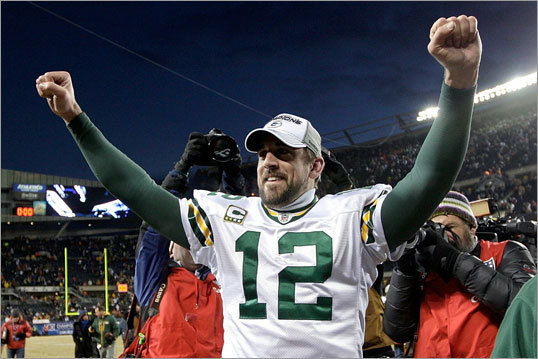 Packers 21, Bears 14 Packers Aaron Rodgers celebrated his team's win and place in the Super Bowl.