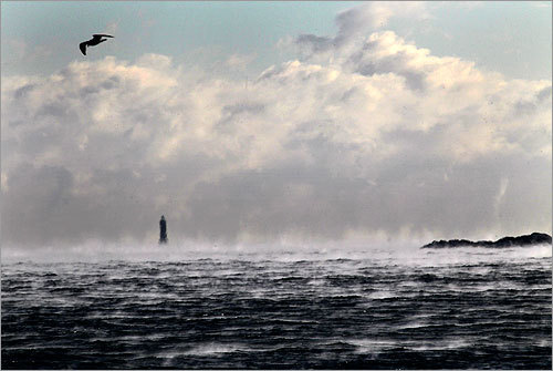 Warm ocean waters off of Scituate, caused steam to rise off of the water. Minot's Lighthouse in the background appeared blurry due to steam, fog, and a morning cloud bank.