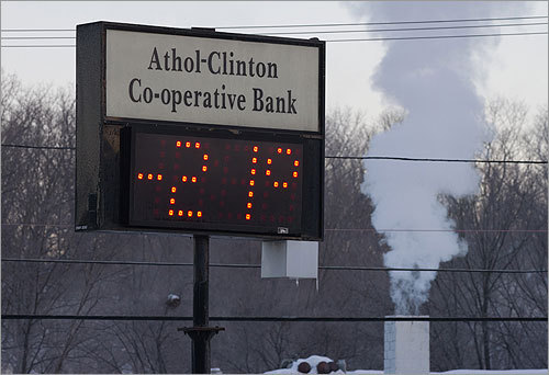 As sub-zero temperatures creep into New England , Bostonians are preparing for the winter blast the way they know best: by bundling up. In Athol, the temperature fell as low as minus 22. Here are scenes from around the region as the temperature begins to drop toward five-year lows.