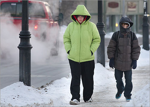 Lisa Beckwith walked her son David, 11, to the bus stop on a frigid Main Street in Athol, where the temperature reached as low as minus 23.