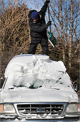 In Framingham, Keith Saviano dug out his truck from the roof down.