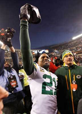 Packers 21, Bears 14 The Packers overcame a sloppy game by Aaron Rodgers (17/30, 2 interceptions) and had two key interceptions in the fourth quarter which pushed them to the Super Bowl, defeating the Bears 21-14. Pictured: Cornerback Charles Woodson celebrated after the win.