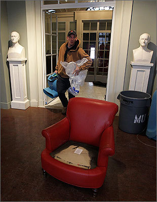 The Athenaeum was founded in 1807 and is one of the oldest independent libraries in the United States. It will be closed for the next few days, officials said. Mike Gagnon brings in a fan to help dry out the building.