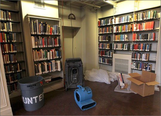 The cause of the leak still hasn't been determined, but it did happen on one of the coldest days in years so frozen pipes are a suspect. The flooding started on the first floor of the building on Beacon Street. 'It was like Niagara Falls,' said librarian Paula D. Matthews.