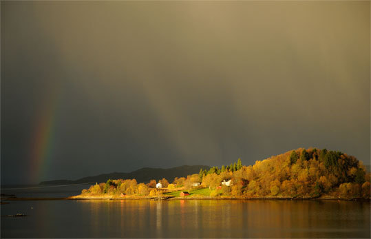 The morning sun lights up an island near Ornes, a remote village of about 1,500 people in western Norway.