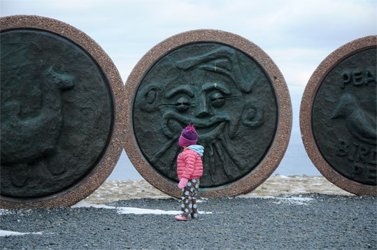 Carved stones stand on the open plateau next to the Nordkapp visitors center and monument.