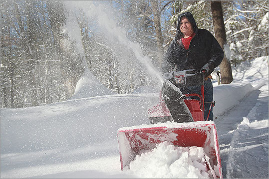 Another snowstorm hit Boston Wednesday night into Thursday morning, dumping more than a foot of snow in some parts of a state that has received more than five feet this season. As the storm subsided and the sun came out, residents and snow removal workers added to the growing mounds of snow around the region. Gary Shults, 72, used a snow-thrower for his driveway.