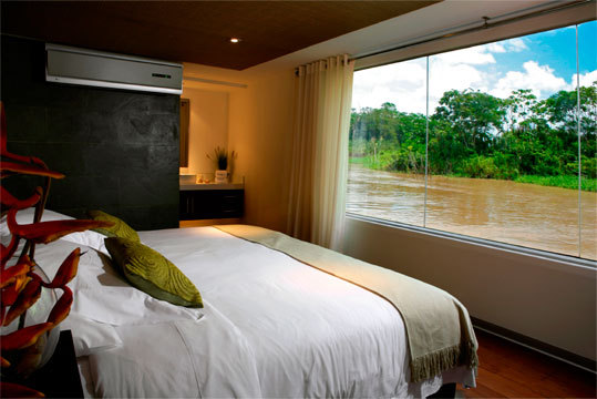 All the suites on Aqua Expeditions are air-conditioned and offer views of the Amazon.
