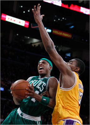 Celtics forward Paul Pierce drive to the basket on Lakers center Andrew Bynum.