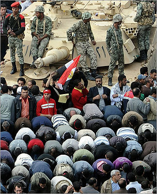 Egyptian demonstators prayed in front of an Abrams tank stationed in Tahrir Square in the sixth day of protests against Hosni Mubarak's regime.