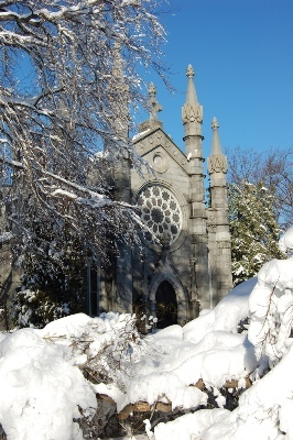 Bigelow Chapel, surrounded by snow, was originally built in the 1840s and rebuilt in the 1850s. The chapel was designed in the Gothic Revival style by Dr. Jacob Bigelow working with architect Gridley J. F. Bryant.