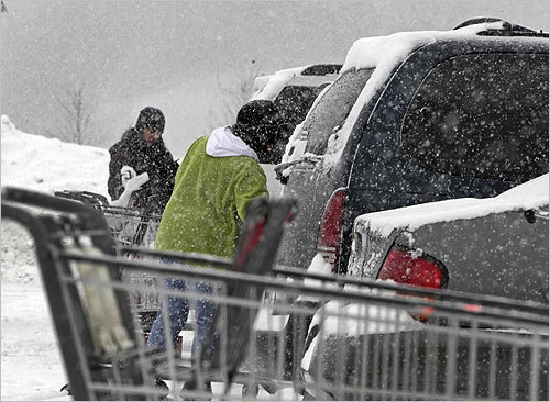 A parking lot at the Market Basket store on Pleasant Valley Street in Methuen was busy as customers stocked up for the two-day snowstorm on Tuesday.