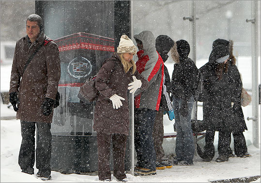 People waited for the bus at the St. James Avenue bus stop in Copley Square on Tuesday.