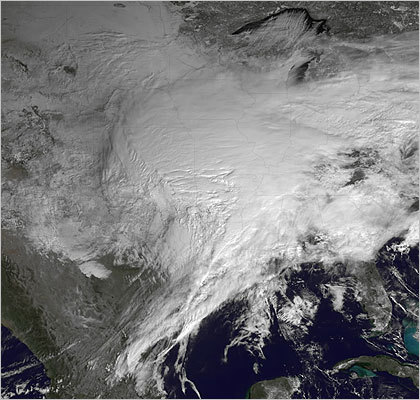 This satellite image from the National Oceanic and Atmospheric Administration showed the storm covering the United States on Tuesday.