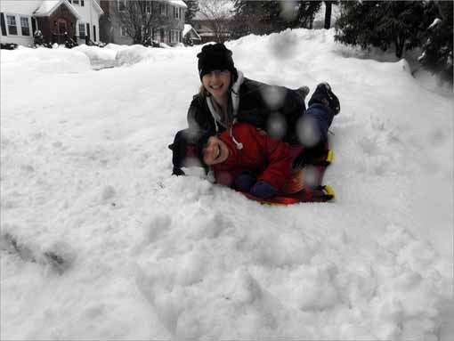Reader Photos Colette O'Leary, in navy, plays with her sister Elise O'Leary, in red, during a recent snow storm in Milton. Send us your photos: globesouth@globe.com or tweet them to @MiltonUpdate .