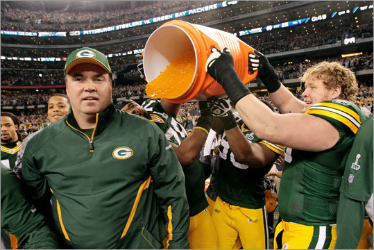 Packers coach Mike McCarthy received a traditional Gatorade shower after the Green Bay Packers defeated the Pittsburgh Steelers 31-25 in Super Bowl XLV in Dallas.